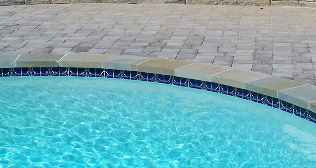 Stone pavers are an ideal surface for pool surrounds, providing traction while staying cool in the sun.
