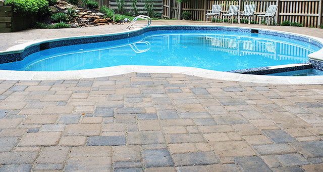 Pavers give a unique signature to your pool surround area.