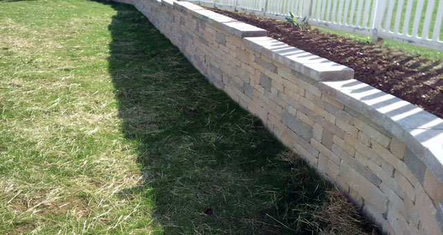 Interlocking and natural stone retaining walls built to withstand the test of time.
