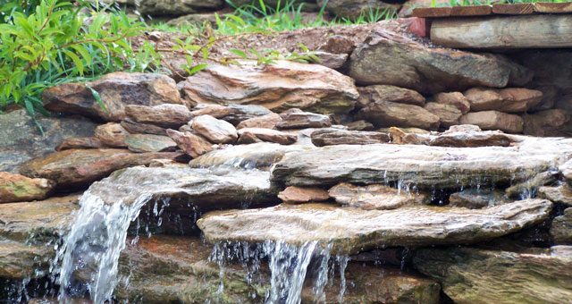 Natural stone landscape water features including ponds, waterfalls, even creeks!